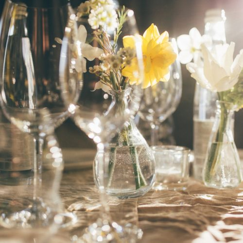 Wineglasses, bottle of water. Wedding banquet at sunset